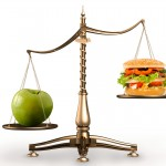 bigstock-photo-apple-and-hamburger-on-scales-573786